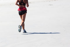 Jogging at the beach Royalty Free Stock Photography