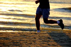 Jogging on the beach Stock Photo