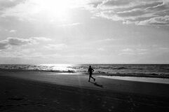 Jogging at beach Stock Images