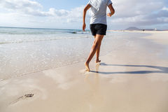 Jogging on beach Stock Image