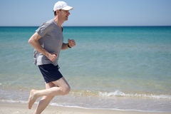 Jogging on a beach Stock Image