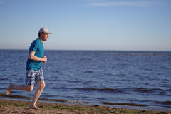 Jogging on a beach Stock Photos