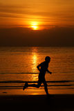 Jogging at beach on Langkawi island, Malaysia. Jogging in the sunset at beach on Langkawi island, Malaysia royalty free stock image