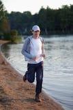Jogging on a beach Stock Photos