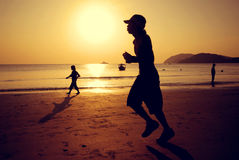 Jogging Beach Sunset Exercise Moving Concept Stock Images