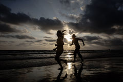 Jogging on the beach Royalty Free Stock Photography