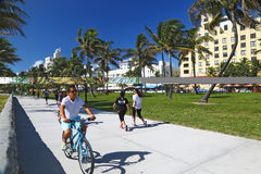 Jogging and biking in Lummus Park, Miami Beach Stock Images