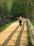 Jogging on the Canal Royalty Free Stock Photo