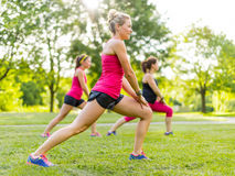 Jogging coach streching with clients Stock Images