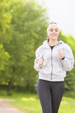 Jogging Concept: Young Running Fitness Woman Training Outdoors i Stock Photos