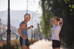 Jogging couple planning running route  and setting music Stock Photos