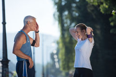 Jogging couple planning running route  and setting music Royalty Free Stock Photo