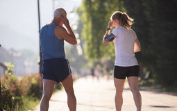 Jogging couple planning running route  and setting music Royalty Free Stock Images