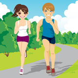 Jogging Couple Running In Park. Illustration of healthy young jogging couple happy running in park Stock Photography