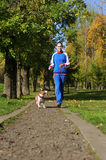 Jogging with dog Royalty Free Stock Photo