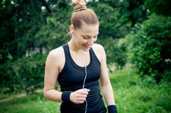 Jogging and enjoying music Stock Images