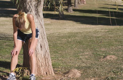 Jogging Exhaustion. Female jogger exhausted after a hard run Royalty Free Stock Photos