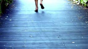 Jogging feet closeup stock video footage