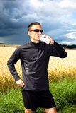 Jogging through the fields Stock Photography