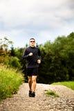 Jogging through the fields Stock Photos