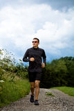 Jogging through the fields Stock Images