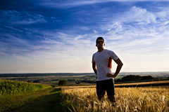 Jogging through the fields Stock Photo