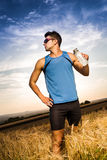 Jogging through the fields Stock Image
