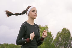 Jogging and Fiftenss Concepts: Portrait of Beautiful Caucasian Y Royalty Free Stock Photo