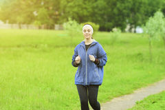 Jogging and Fitness Concepts: Portrait of Beautiful Caucasian Y Stock Photos