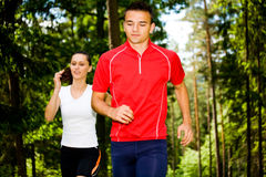 Jogging in forest Stock Photo