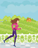 Jogging girl in the countryside Royalty Free Stock Photos