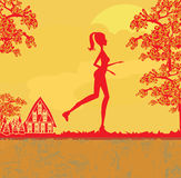 Jogging girl in sunset Stock Photography
