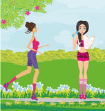 Jogging girls in summer at the park Royalty Free Stock Image
