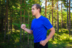 Jogging - handsome man running in forest Royalty Free Stock Photo