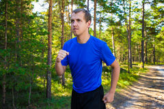 Jogging - handsome man running in park or forest Royalty Free Stock Image