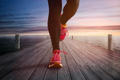 Jogging on a Jetty. Jogging on a long Jetty Royalty Free Stock Photography