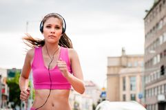 Jogging and listening music Royalty Free Stock Images