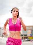 Jogging and listening music Royalty Free Stock Image