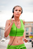 Jogging and listening music Stock Photo