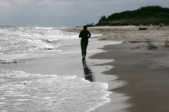 Free Jogging Lonely By The Sea Stock Photo - 701590