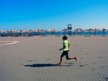 Jogging on the long beach of Ulcinj, Montenegro. royalty free stock photography