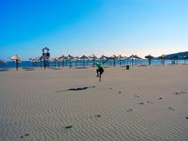 Jogging on the long beach of Ulcinj, Montenegro. stock images
