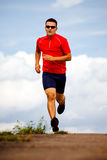 Jogging man 2. A man jogging cross country royalty free stock photography