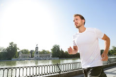 Jogging man running in city park El Retiro Madrid Royalty Free Stock Photos
