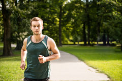 Jogging - man running in nature Royalty Free Stock Images