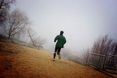 Jogging in the mist Stock Photos