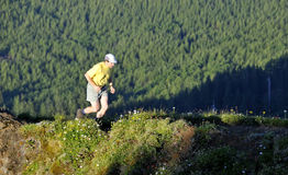 Jogging on Mountain Ridge Stock Image
