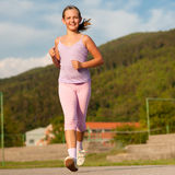 Jogging in the nature by a cute girl Stock Image
