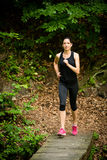 Jogging in nature. Running for health - young woman jogging in nature royalty free stock images