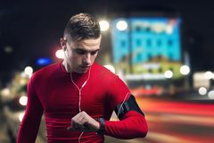 Jogging at night. Young sportsman jogging in the night city stock photo